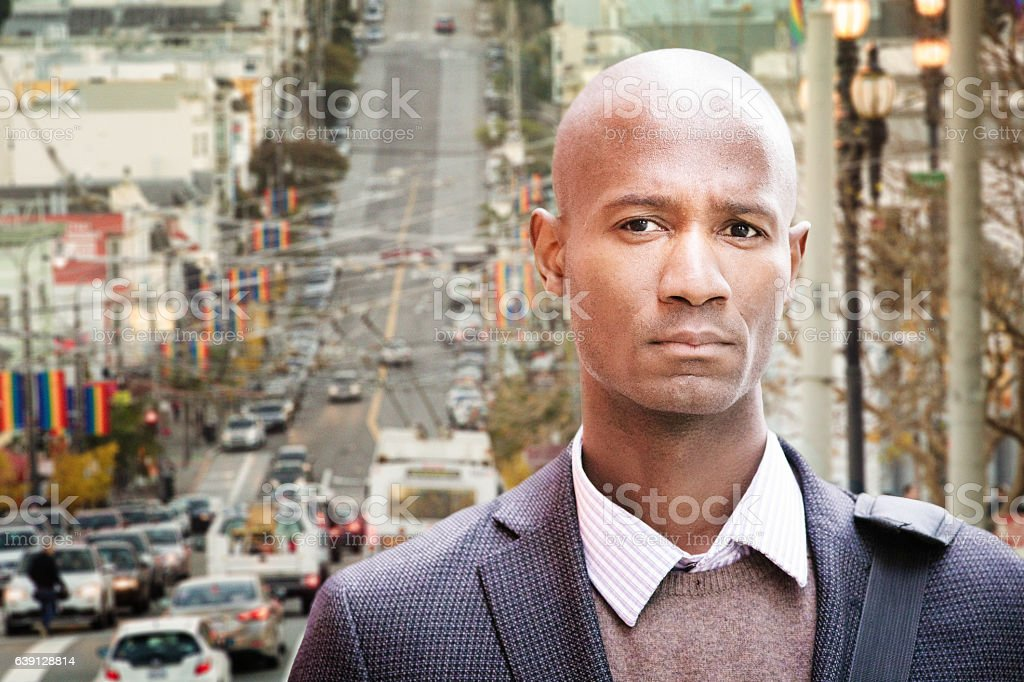 Serious worried professional black man urban portrait San Francisco stock photo