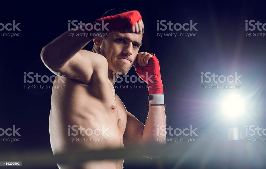 Serious young boxer ready to fight. stock photo