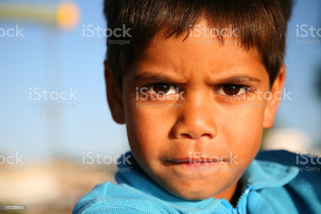 Serious young boy stock photo