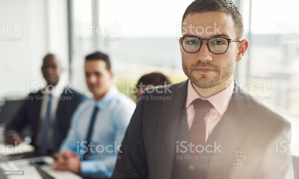 Serious young businessman in a meeting stock photo