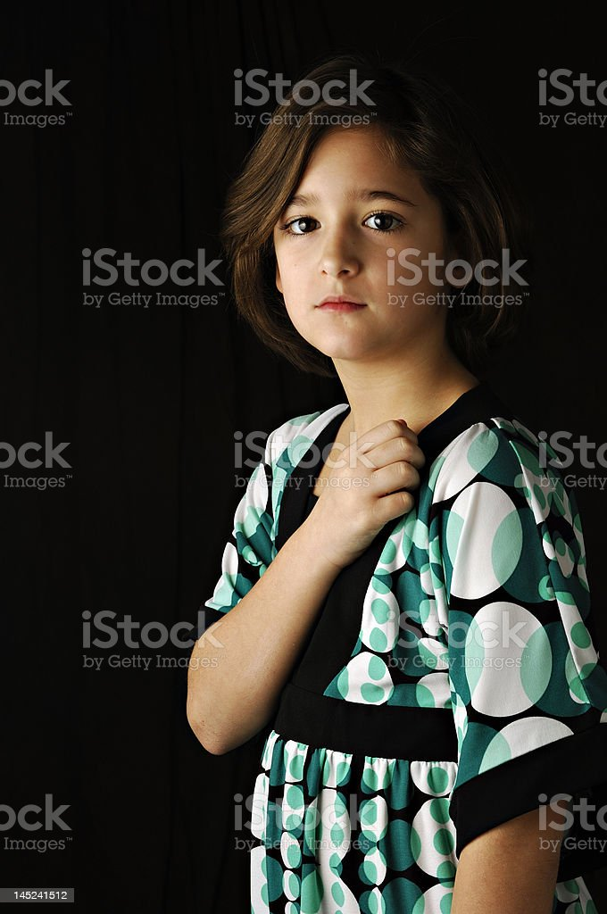 serious young girl holding heart royalty-free stock photo