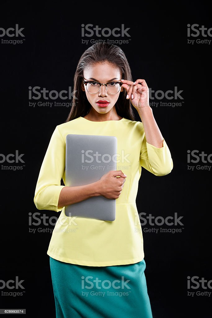 Serious young lady is holding a case stock photo