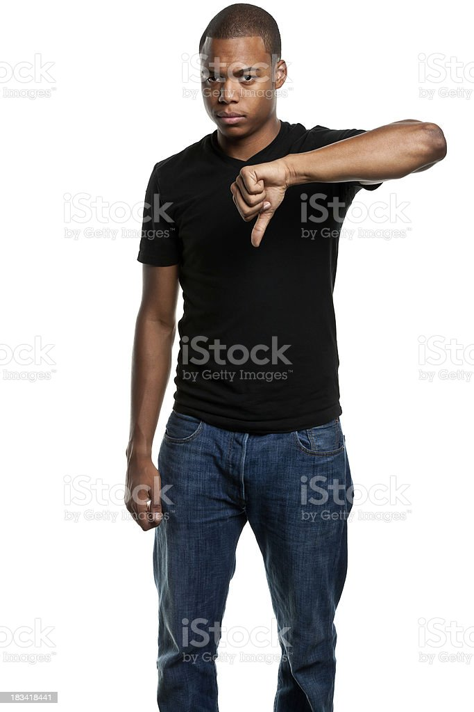 Serious Young Man Gives Thumbs Down stock photo