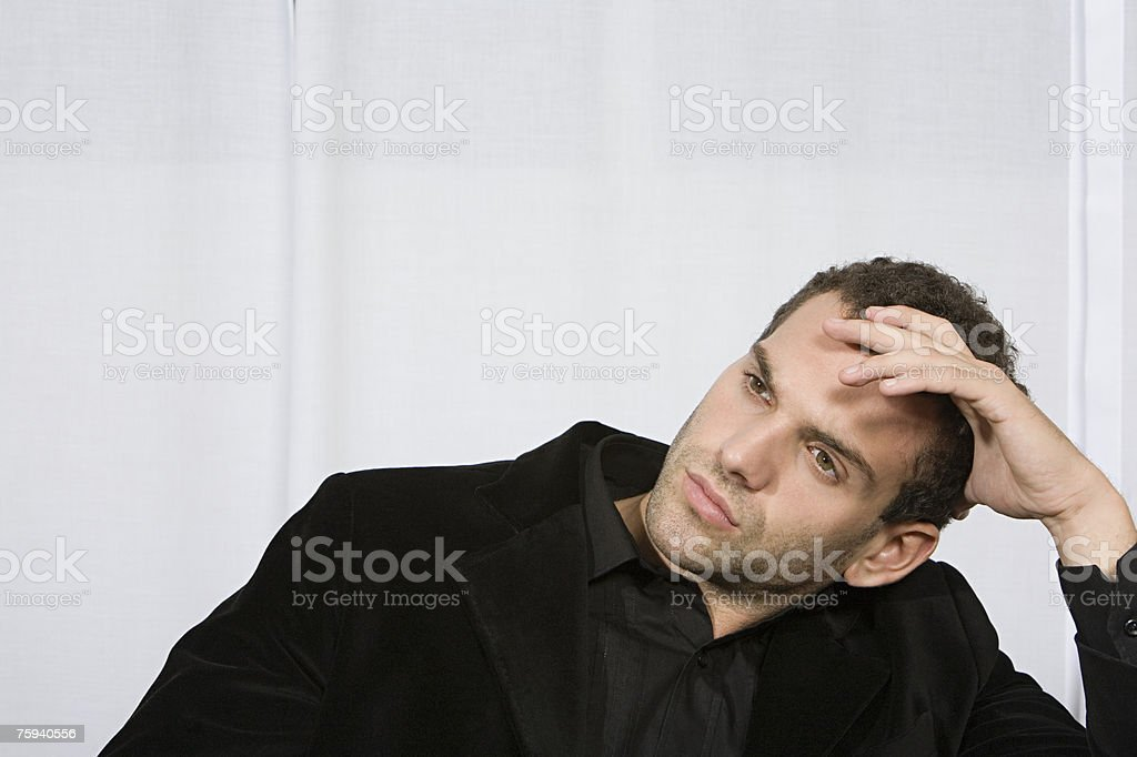 Serious young man stock photo