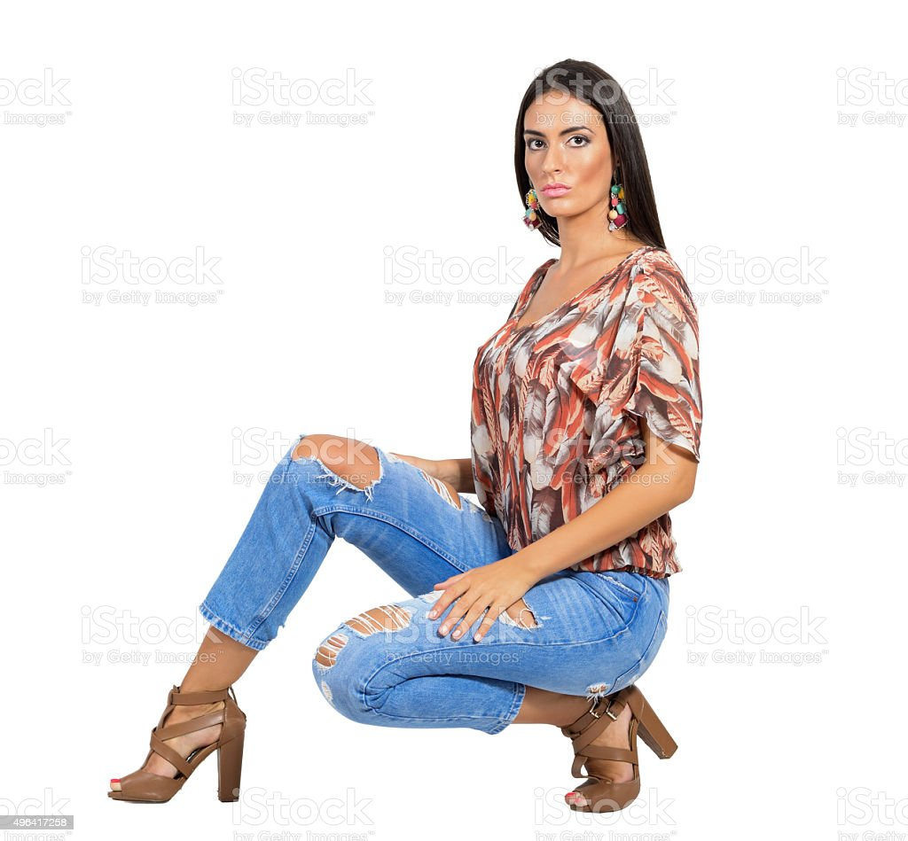 Serious young sensual brunette fashion model posing at camera stock photo