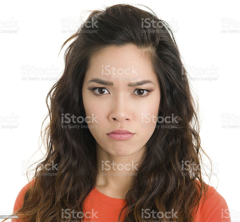 Serious Young Woman Frowning stock photo