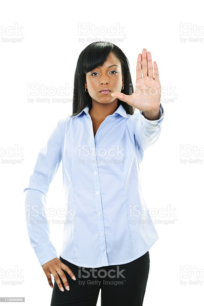 Serious young woman giving stop gesture royalty-free stock photo