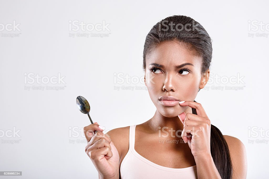 Serious young woman is thinking stock photo