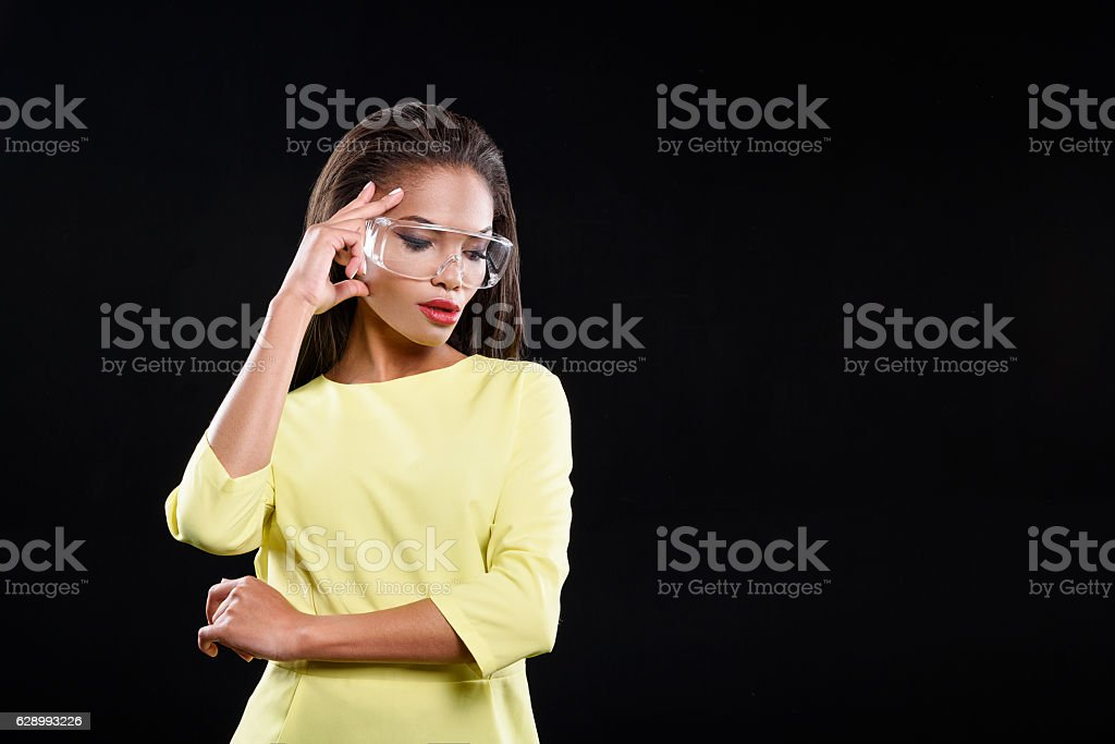 Serious young woman is wearing glasses stock photo