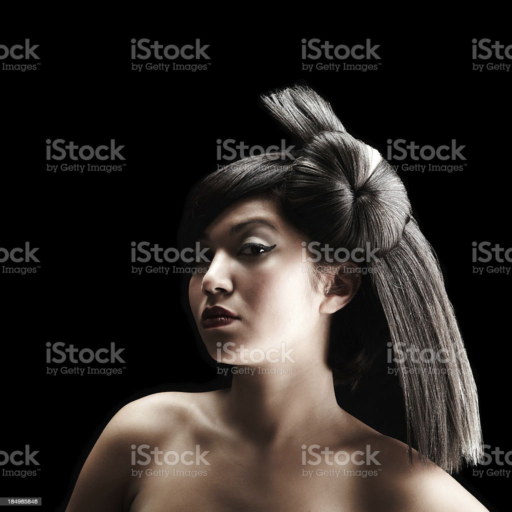 Serious young woman with fashioned hairstyle looking at camera royalty-free stock photo