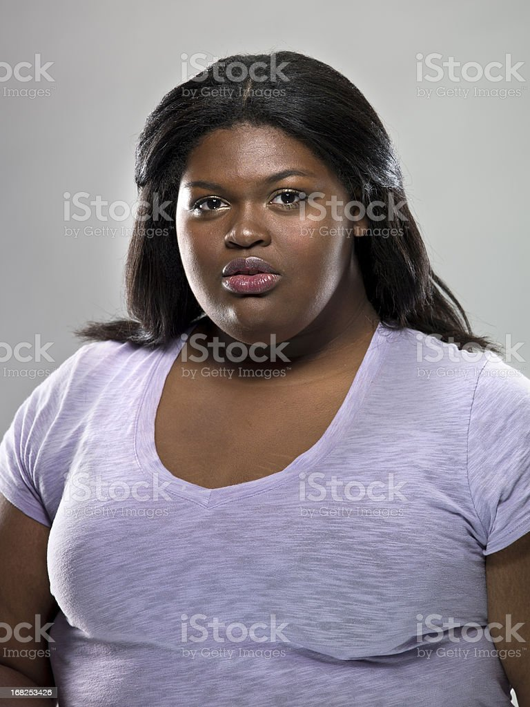 A Serious-Faced Caribbean Woman stock photo