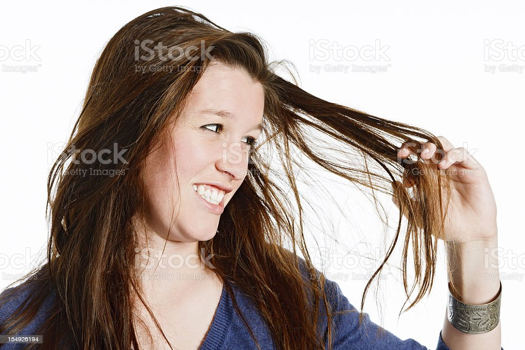 Seriously tangled hair is frustrating this pretty redhead stock photo