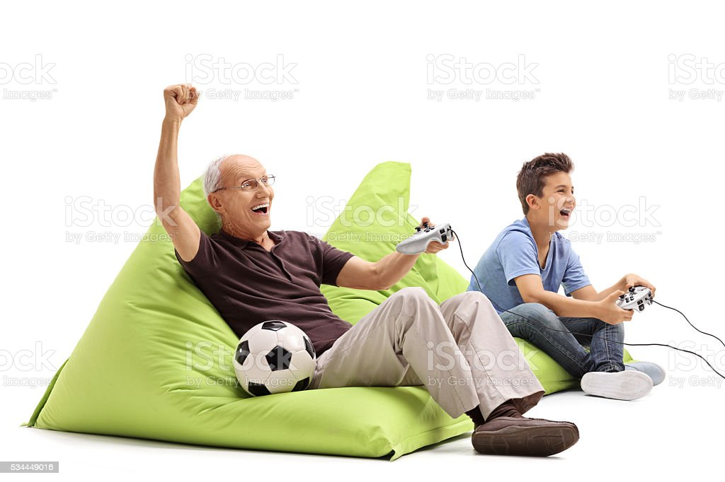 Sernior playing games with his grandson stock photo
