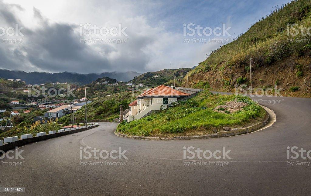 Serpentine mountain road 180 degree turn. Baeutiful and dangerous roads stock photo