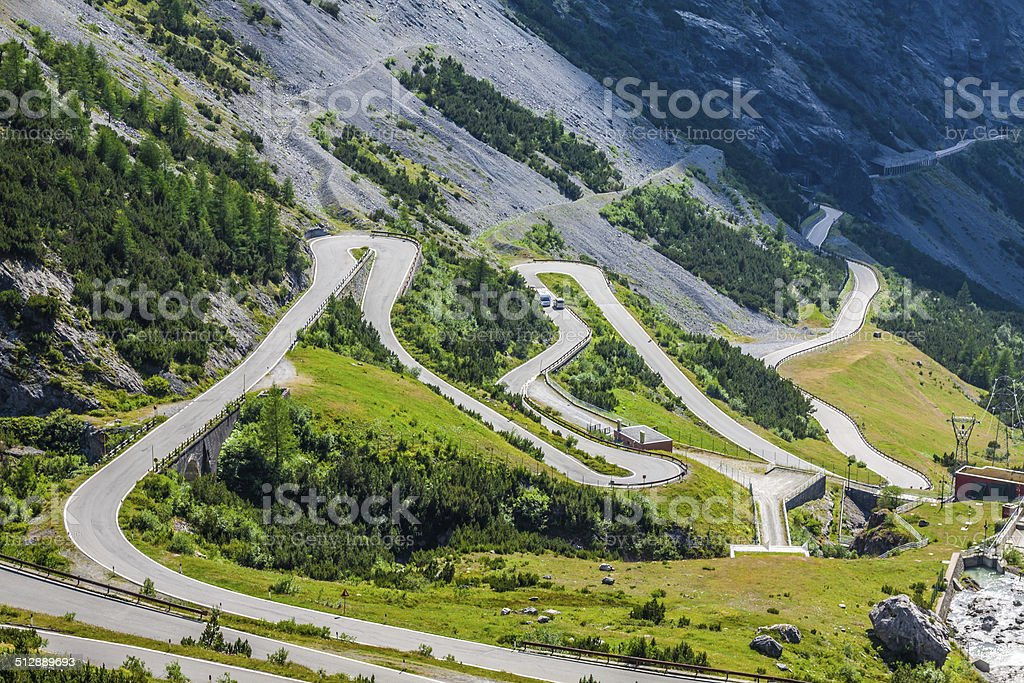 serpentine mountain road in Italian Alps, Stelvio pass, Passo de stock photo