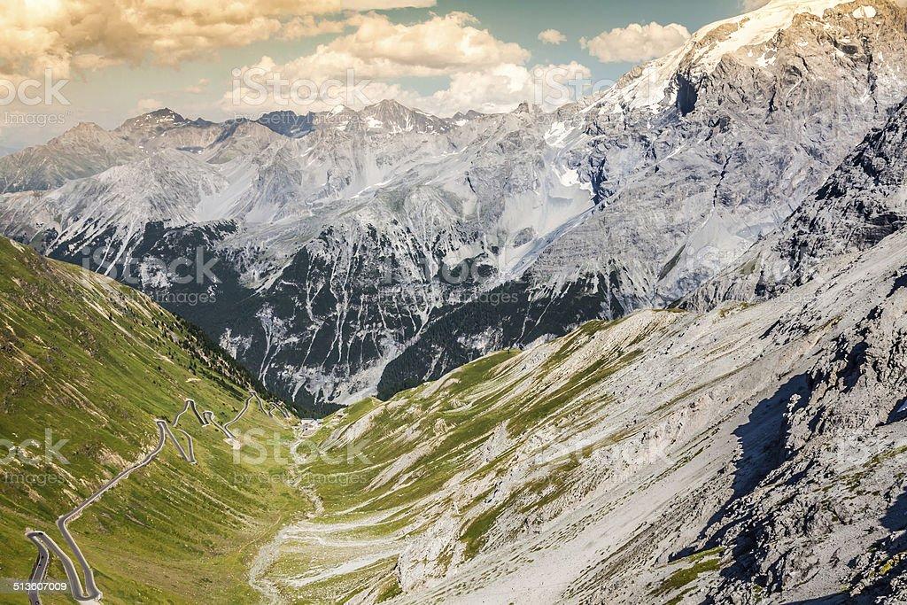 serpentine mountain road in Italian Alps, Stelvio pass, stock photo