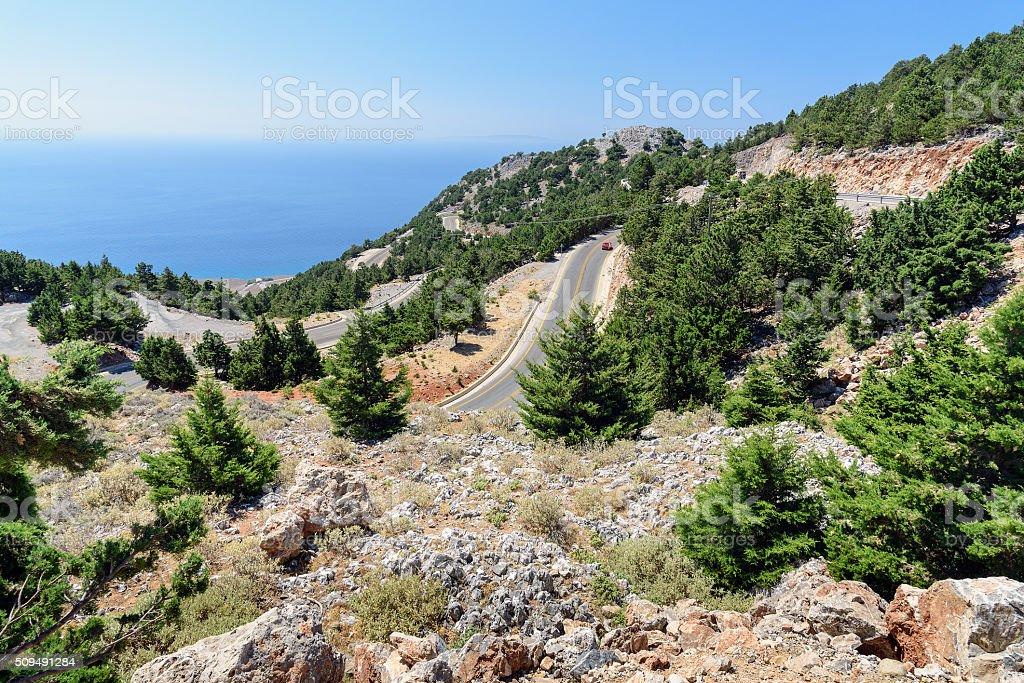 Serpentine road in mountains of Crete island, Greece stock photo