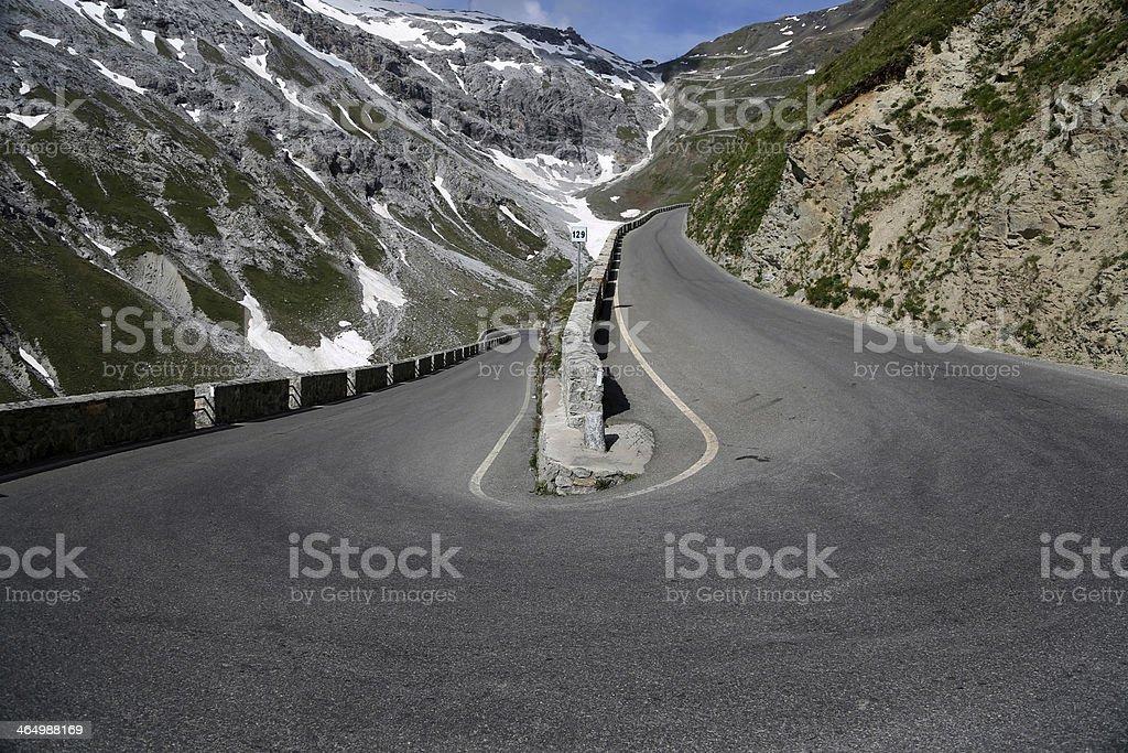 Serpentine road in the italian Alps leads to Stelvio Pass stock photo