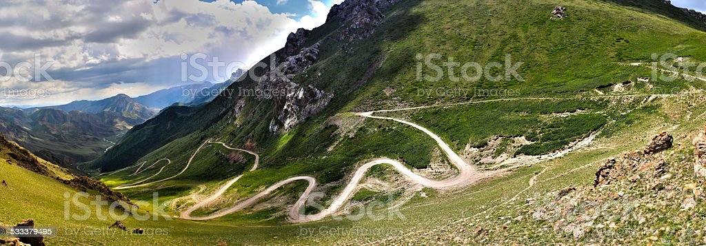 Serpentine road in the mountains stock photo