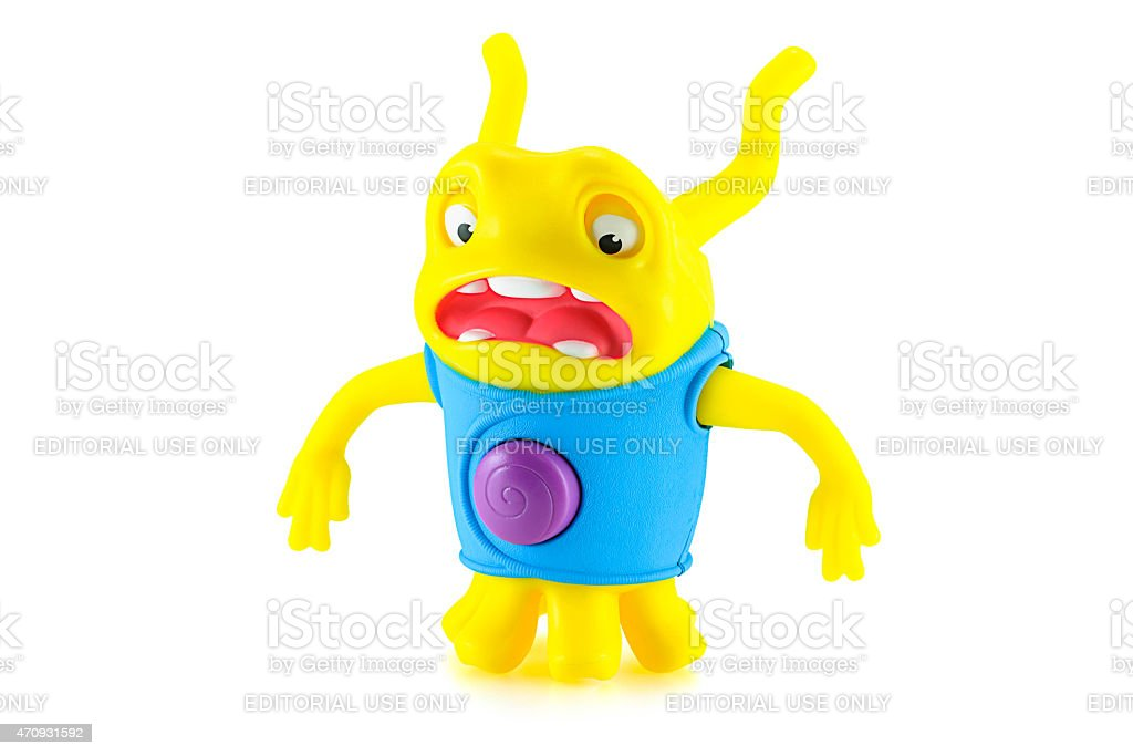 Serprised OH alien yellow color toy character stock photo