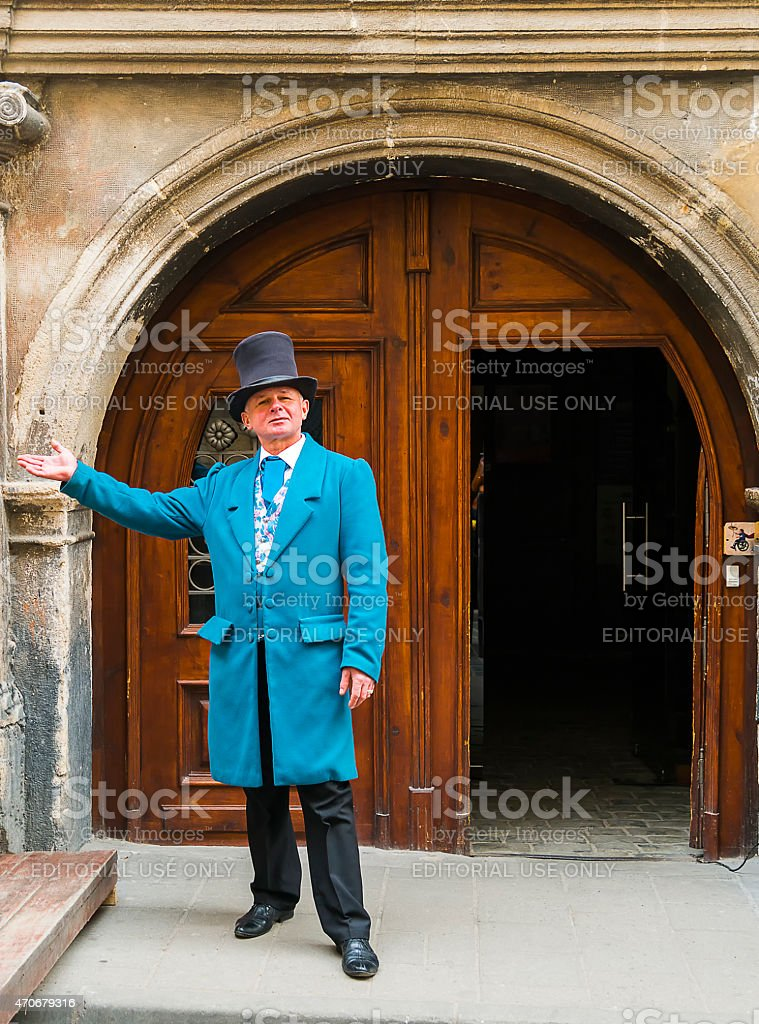 Servant invites enter the old house stock photo