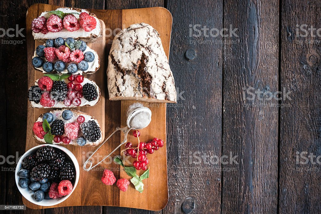 Served cream cheese and berry fruits stock photo