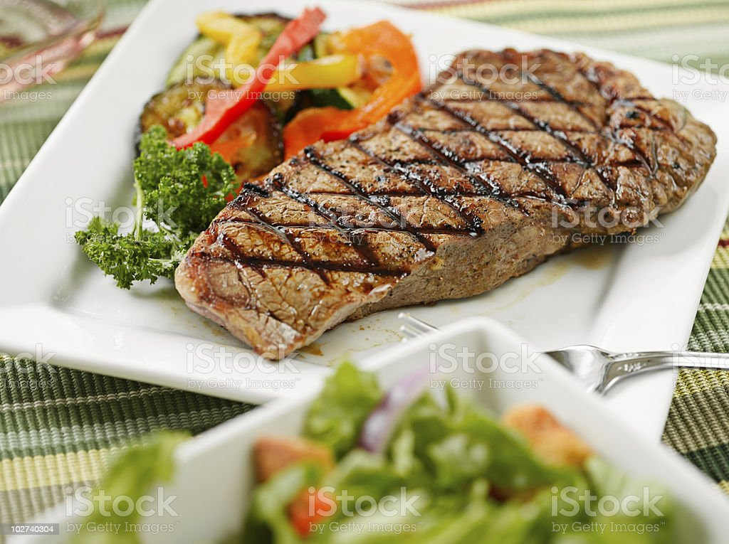 Served dish with steak and vegetables stock photo