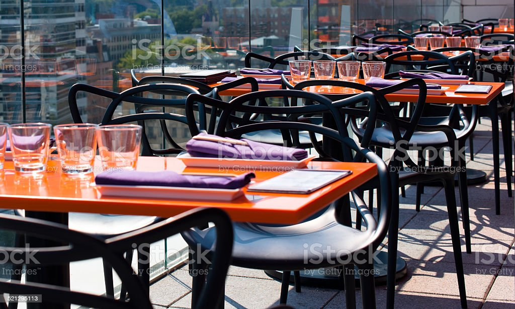 Served outdoor tables in modern restaurant stock photo