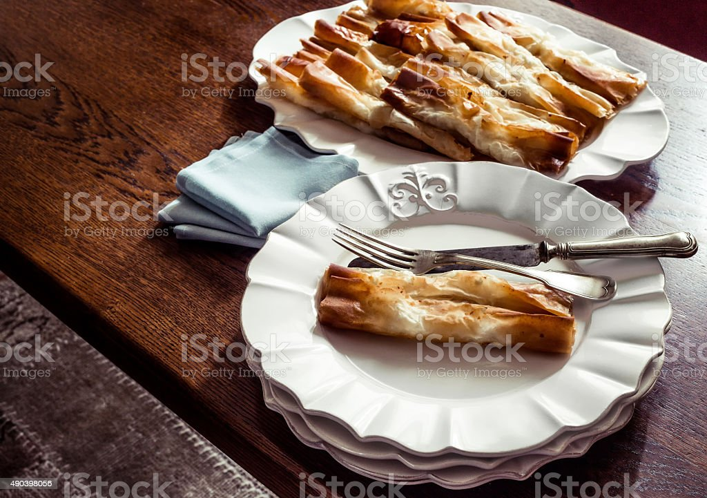 Served pastry in porcelain plates on wooden table stock photo
