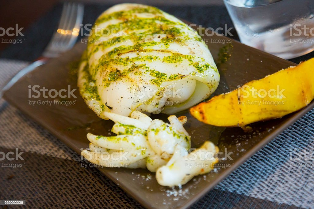 served roasted cuttlefish stock photo