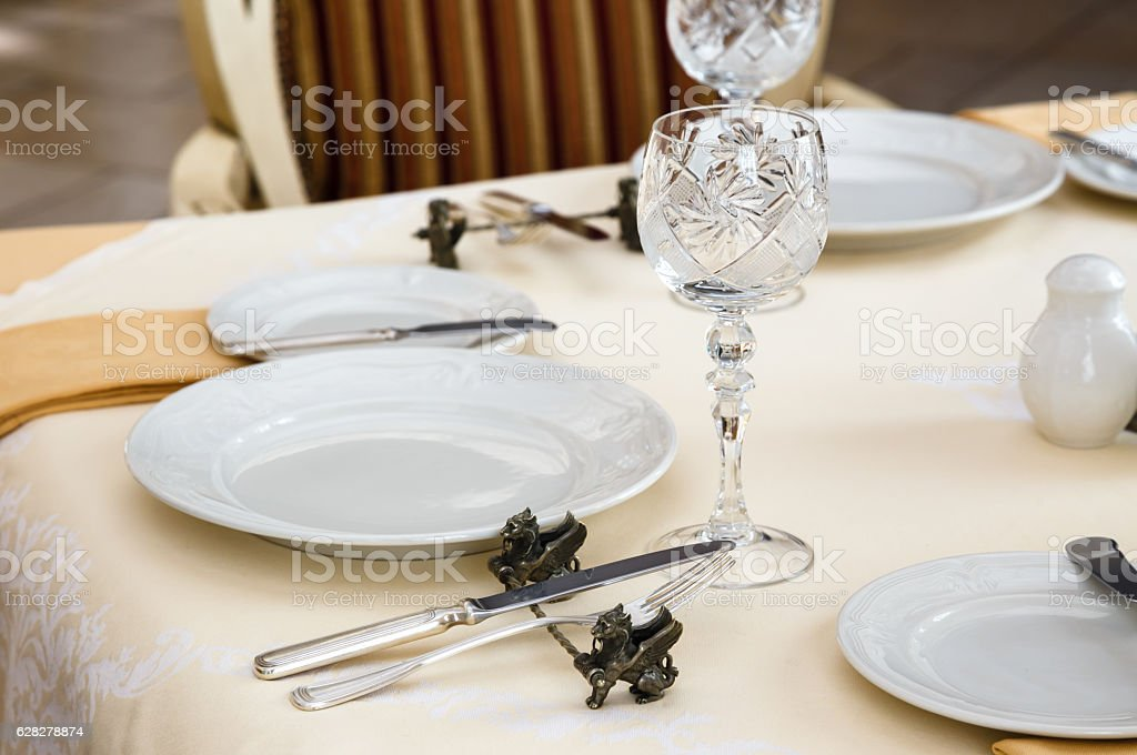 Served table in a retro luxury hotel restaurant close up stock photo
