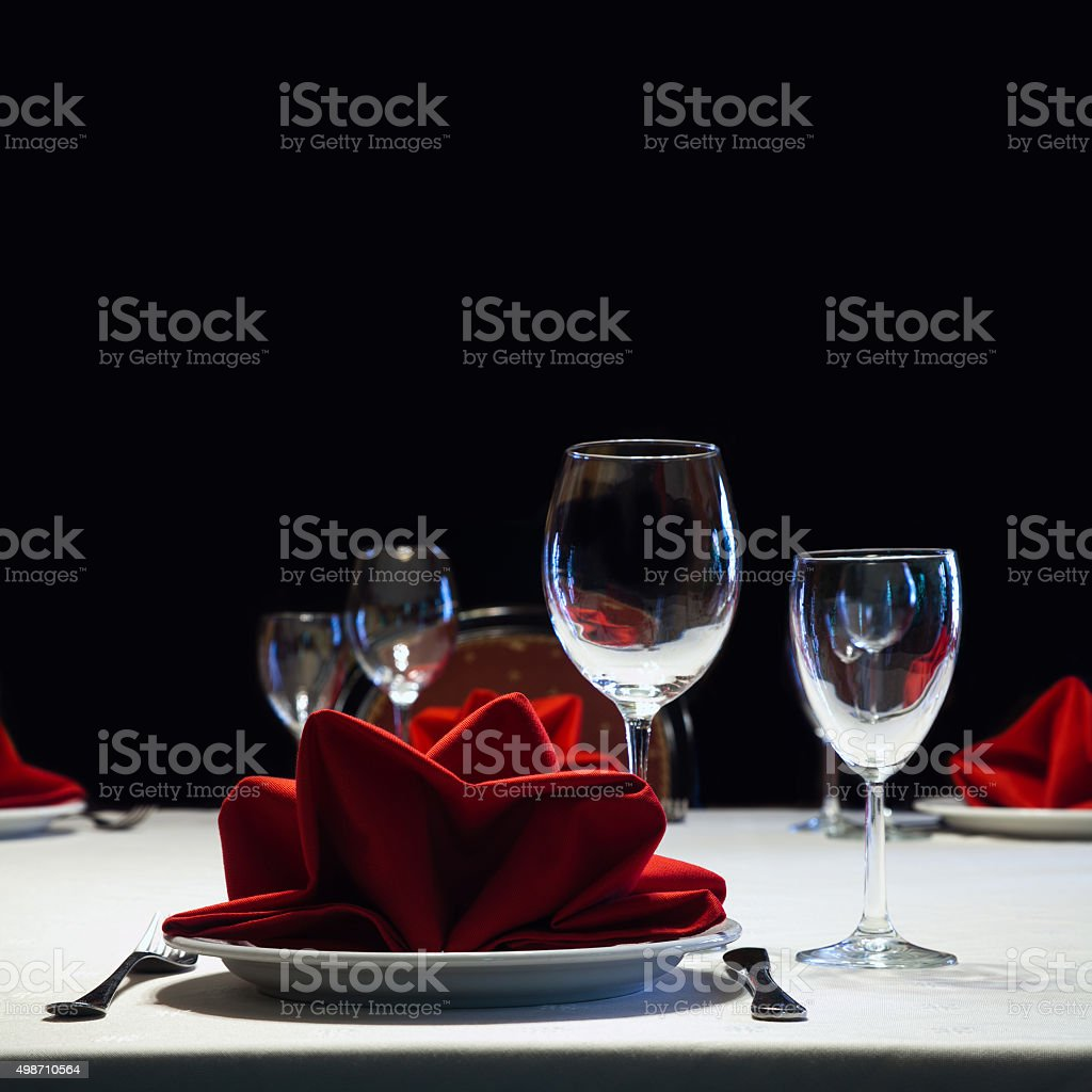 Served table. Romantic restaurant interior with a bright tablecloth, napkins stock photo