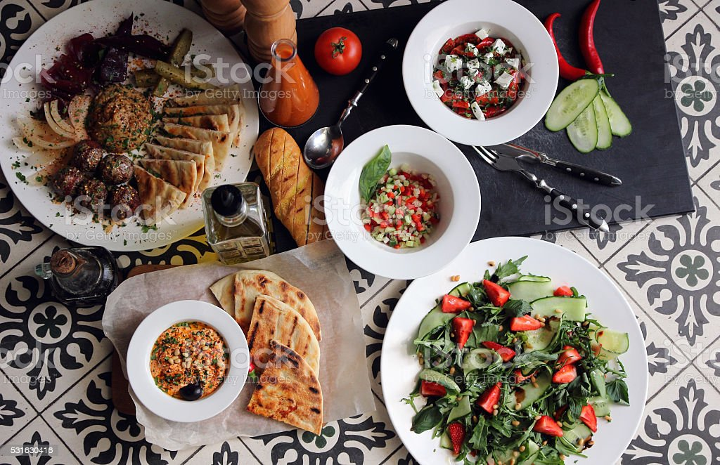 Served table with different dishes and snacks.. stock photo