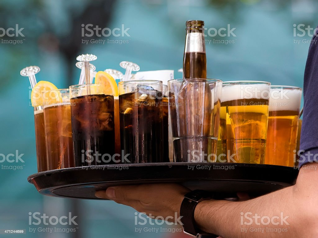 Server holding a tray of various types of drinks stock photo
