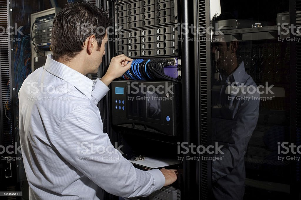 Server Network Technician Working on Cable Connections royalty-free stock photo