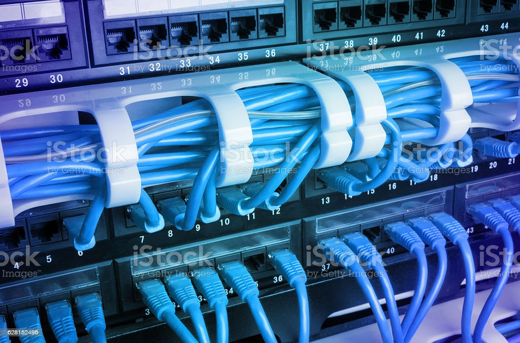 Server rack with blue cables stock photo