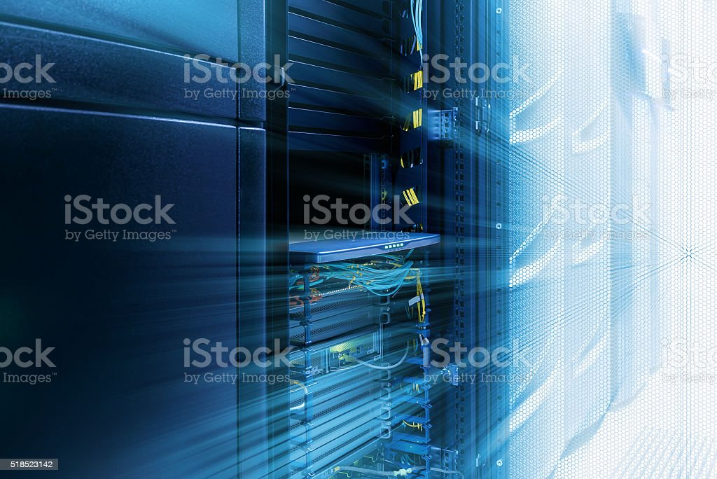 server room with rows of modern mainframes stock photo