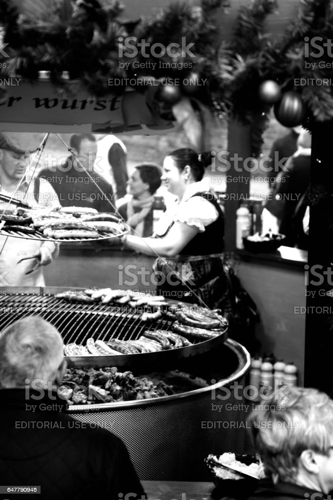 Servers on a bratwurst stall stock photo
