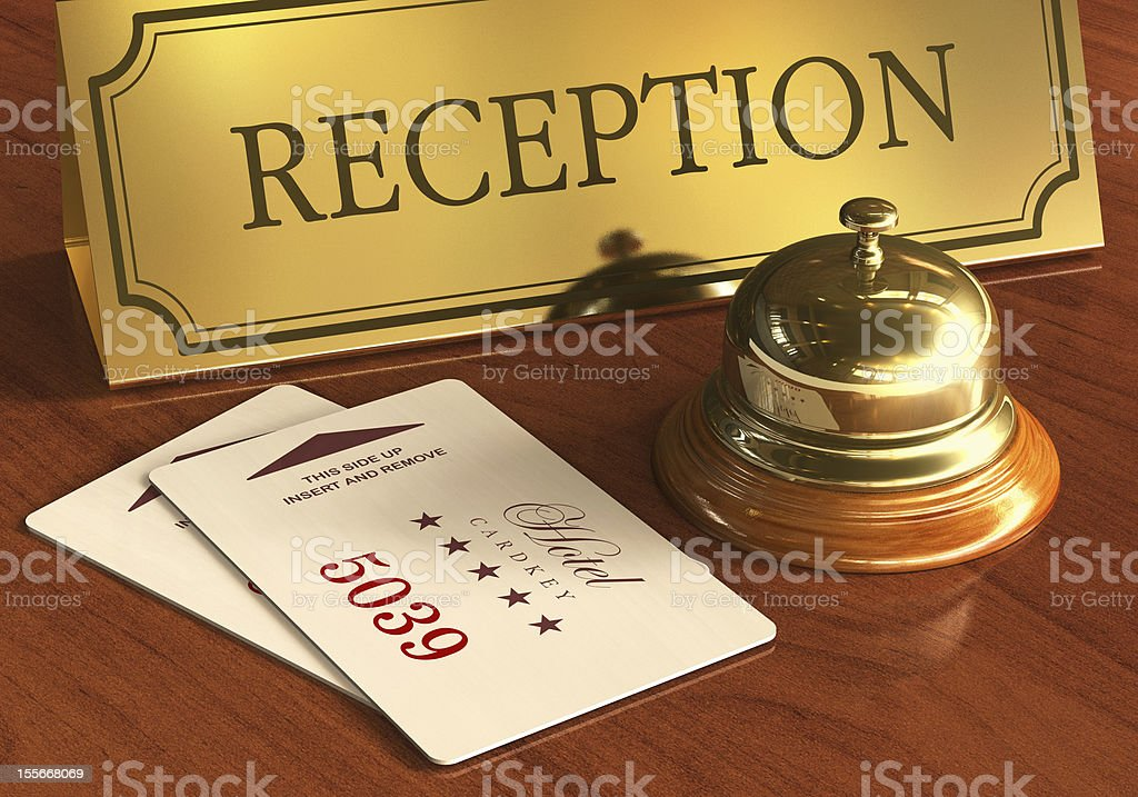 Service bell and cardkeys on hotel reception desk royalty-free stock photo