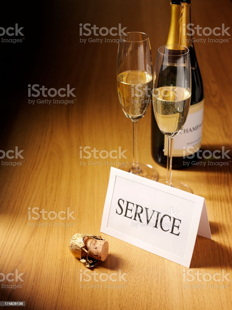 Service Card on a Desk with Champagne royalty-free stock photo
