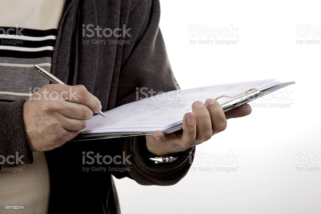 Service employee taking notes on a clipboard about construction change stock photo