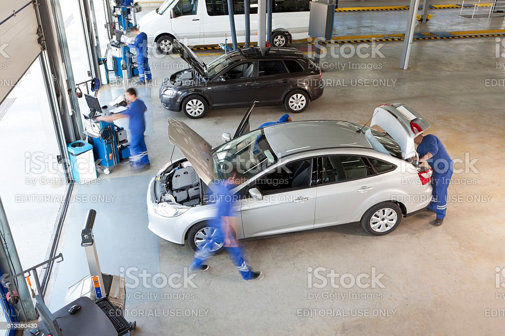 service employee  working in vehicle service stock photo