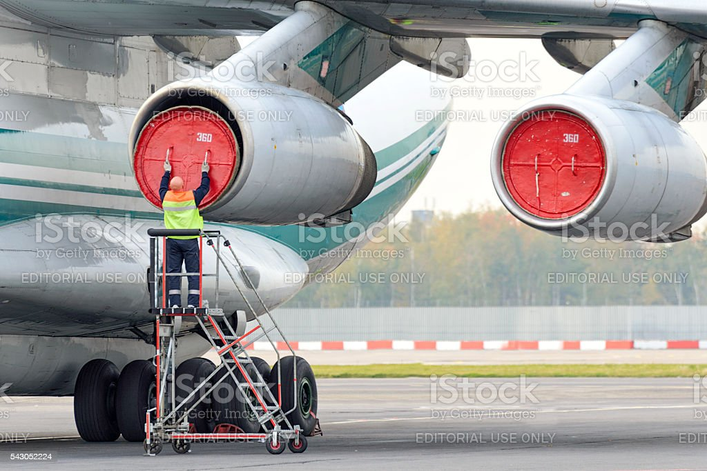 Service Engineer serves a jet engine stock photo