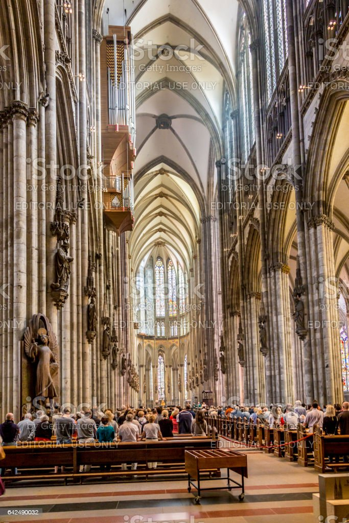 service held in Central nave of Cologne Cathedral, Germany stock photo