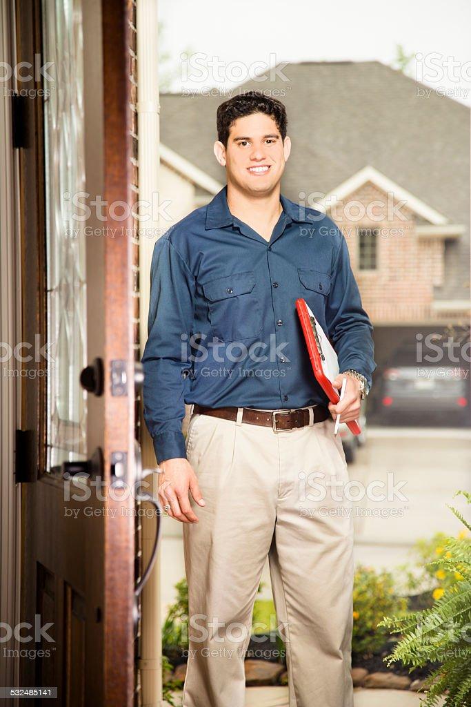Service Industry: Latin descent salesman at customer's front door. stock photo