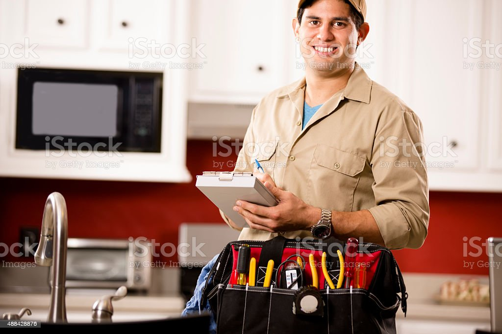 Service Industry:  Latin repairman working at customer's home. Tools. stock photo