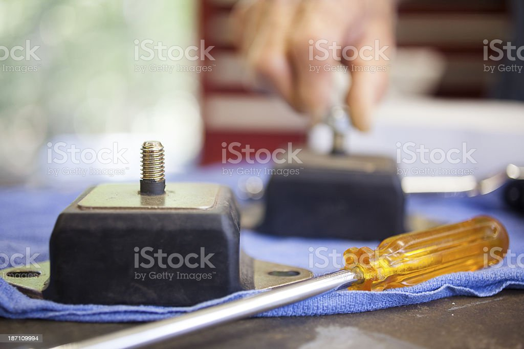 Service Industry:  Mechanic prepares to replace engine mounts. Repair shop. royalty-free stock photo