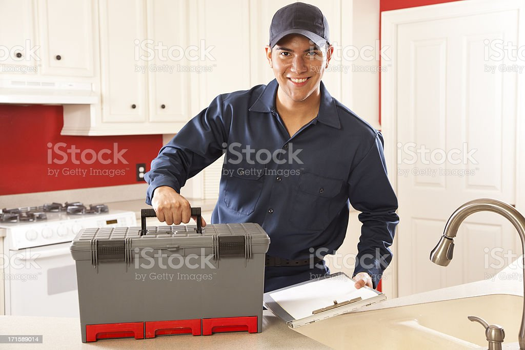 Service Industry: Plumber, repairman arriving for call. Home Kitchen royalty-free stock photo
