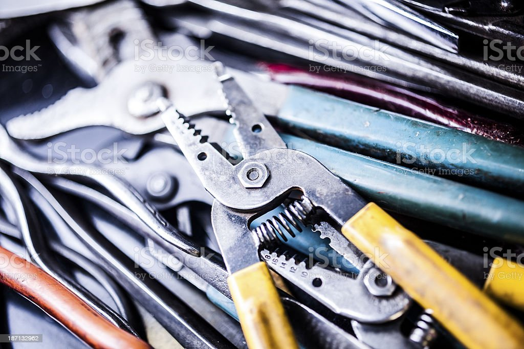 Service Industry:  Wire cutters and assorted work tools in toolbox. royalty-free stock photo