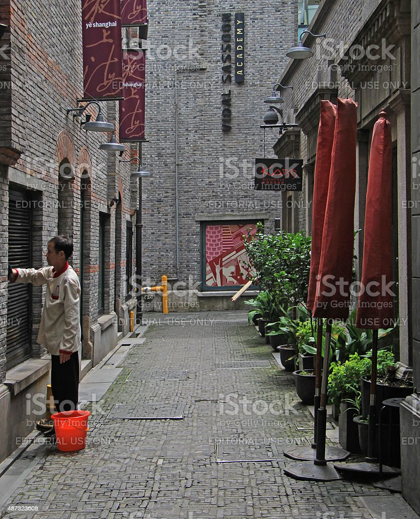 service man is washing window of building stock photo